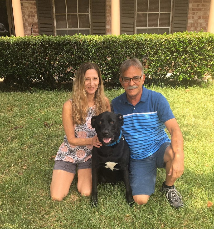 Photo of Patricia Miata, her husband John, and their dog Diesel posing for a photo after Patricia's inspirational recovery from stroke. (Photo credit: John Miata)