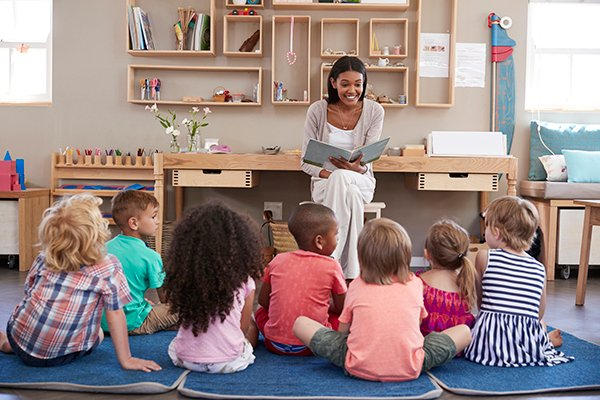 Photo  of teacher reading to preschoolers. (Photo credit: Getty Images)