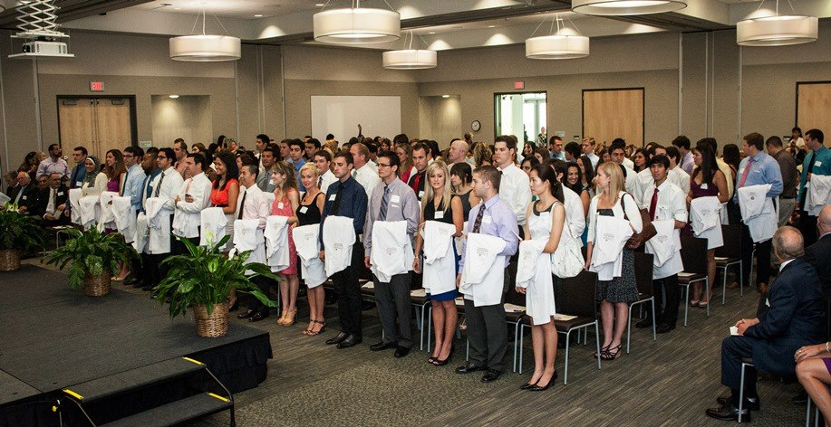 Large group of healthcare professional students at a white coat ceremony