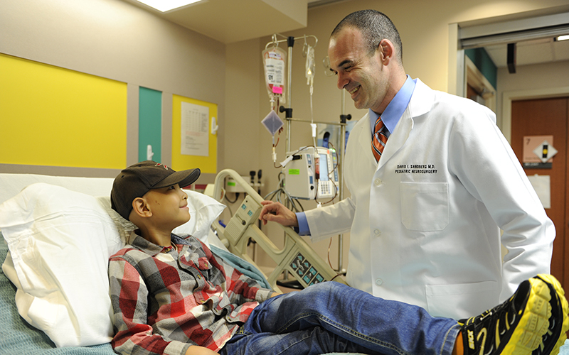 David Sandberg, MD with a young patient